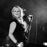 Portrait in Black & white of Michaelle, singering from Heavy Duty band