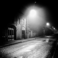 Black and white picture of My street on a foggy night