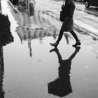 Picture in black & white of a reflection in a puddle, Lyon